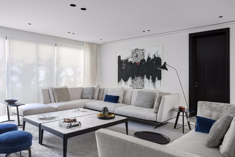Minimalist Interior Design by VSHD Design with Mid-Century Lamps